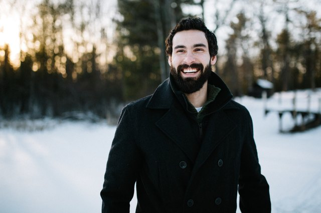 man with glowing skin hanging out outdoors