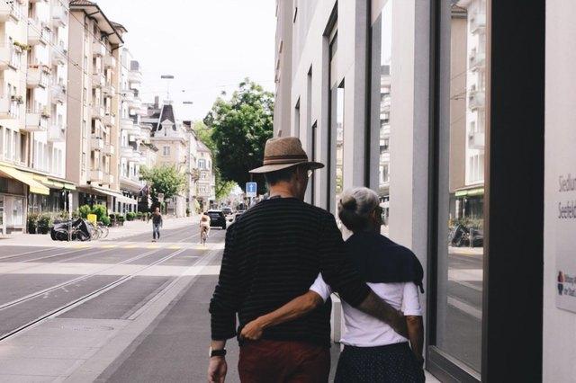 elderly couple taking a srroll