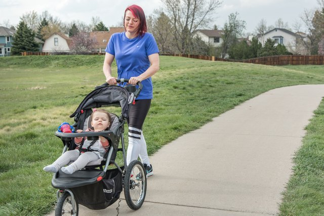 Alanna pushes her daughter in a stroller