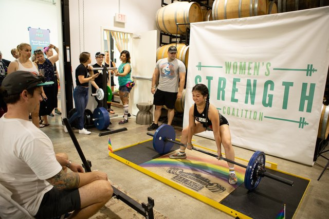 woman deadlifting weight for charity event for Women's Strength Coalition