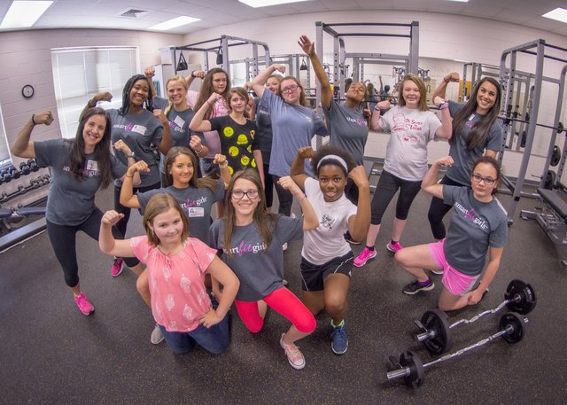 a group of girls participating in a fitness class through Smart Fit Girls