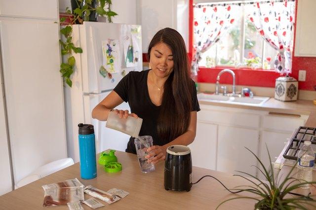 Kristina prepares a protein shake