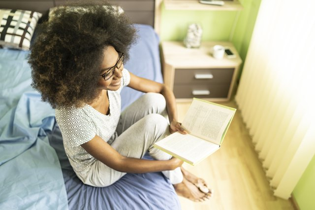 Afro woman reading book