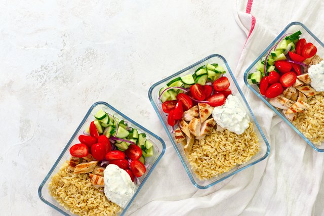 Greek chicken with tzatziki prepared and ready to eat in a take away  lunch boxes