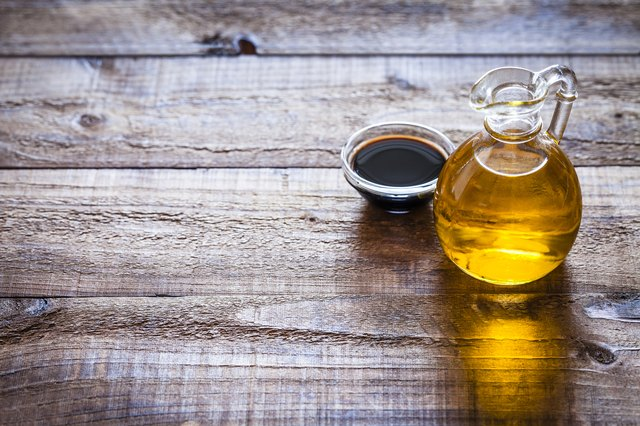Oil and vinegar on rustic wooden table