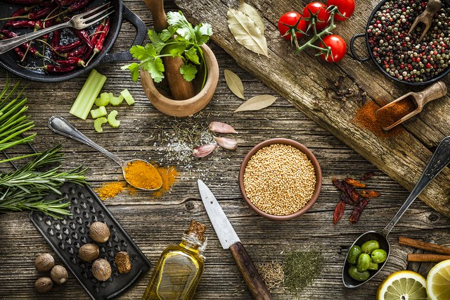 Spices and herbs shot from above on rustic wooden table