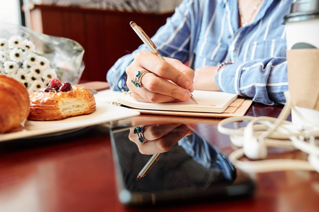 Woman writing plans in diary