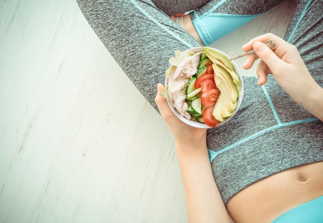 Woman is resting and eating a healthy salad