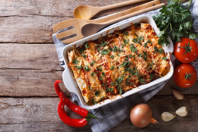 Mexican enchilada in a baking dish horizontal top view