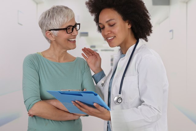 Doctor comforting Mature Woman Patient. Good news concept. Professional medical help,support, advice Female health concept