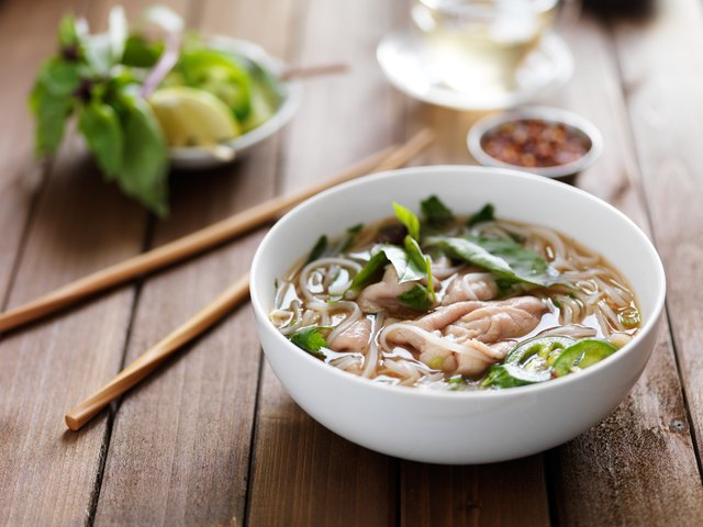vietnamese beef pho with chopsticks on wooden table