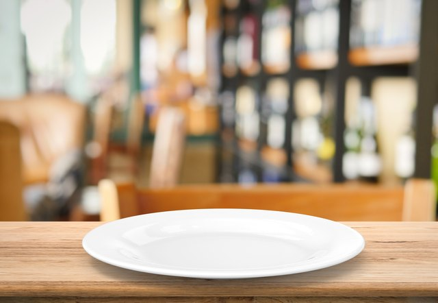 white empty dish on wooden table