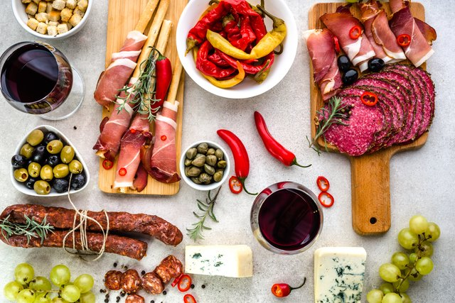 Spanish tapas, traditional food from Spain, wine and appetizers on table, top view