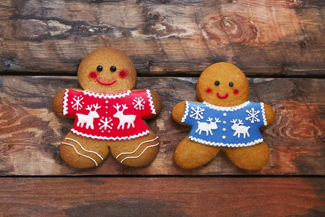 Smiling christmas gingerbread men on wooden background.