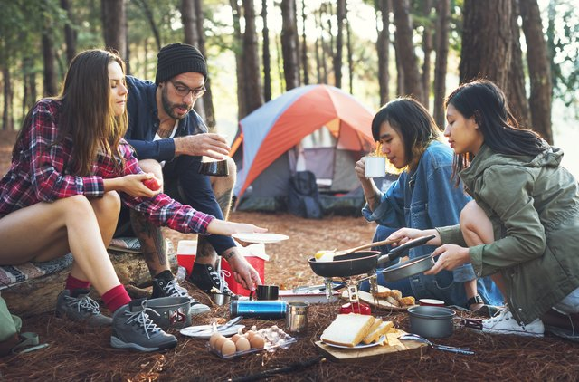 Friends camping in the forest