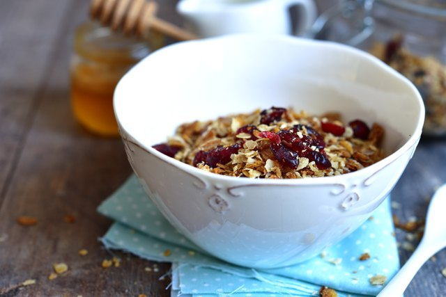 Homemade granola in a white bowl for a breakfast.