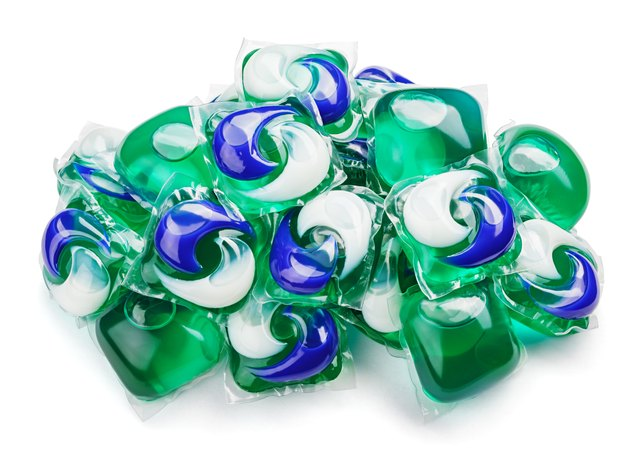 gel capsule pods with laundry detergent on white