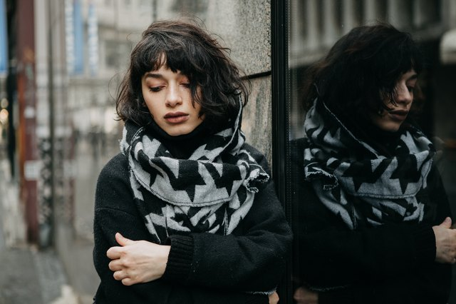 Portrait of a girl outdoors on a cold and gloomy day