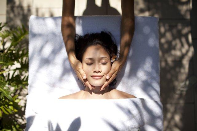 Woman tropical massage facial beauty treatment