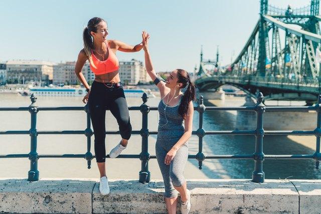 Sports women doing high five after workout