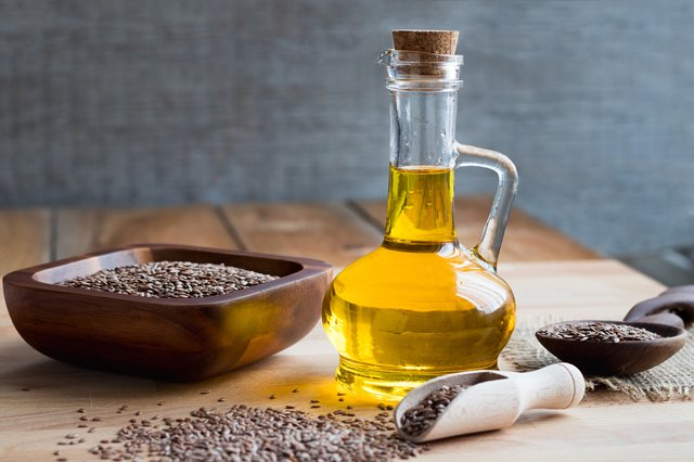 A bottle of flax seed oil on a wooden table