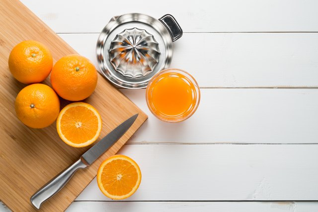 Oranges And Juice On Table
