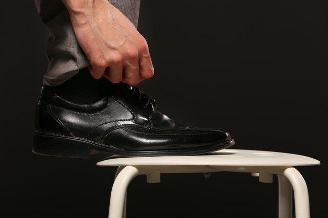 man hand tie shoe