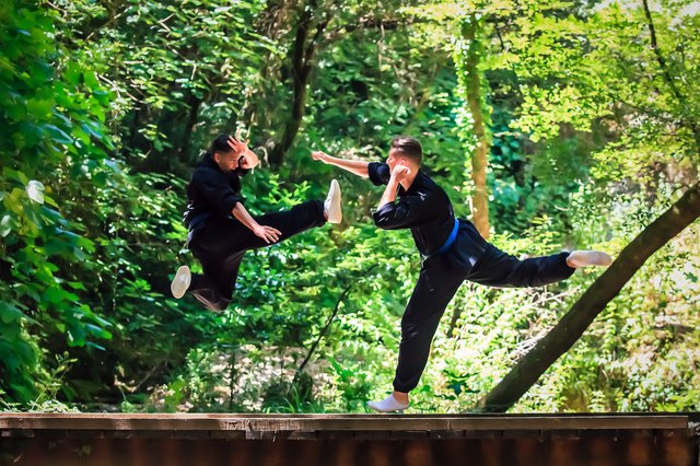 Two boys practicing martial arts. Kick and punch fighting