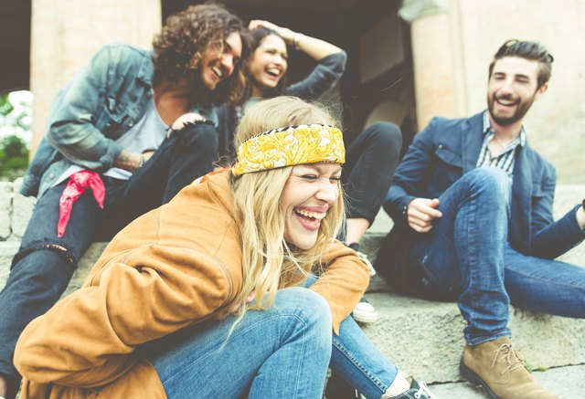Group of four friends laughing out loud outdoor
