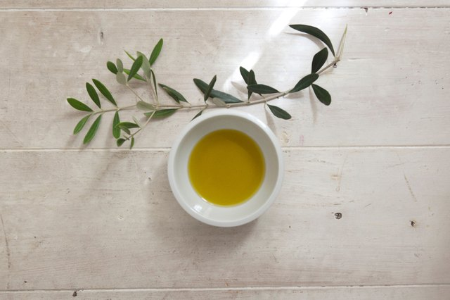 Close-Up Of Olive Oil In Bowl On Table