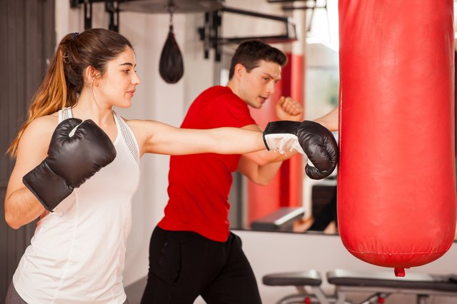 Pretty brunette learning some boxing