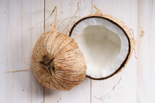 raw coconut meat with shell