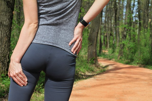 Woman  runner with Cramp in the Hamstring Muscles