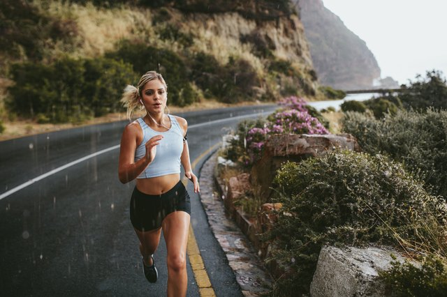 Fitness woman running on highway