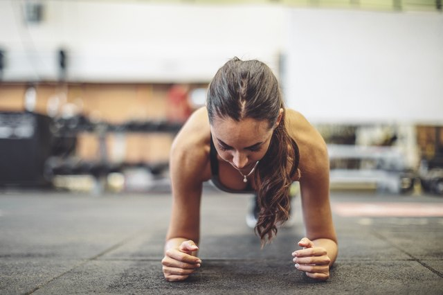 Young woman is doing exercise