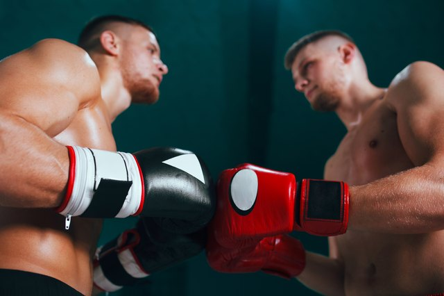 professional boxer on boxing ring, boxing training