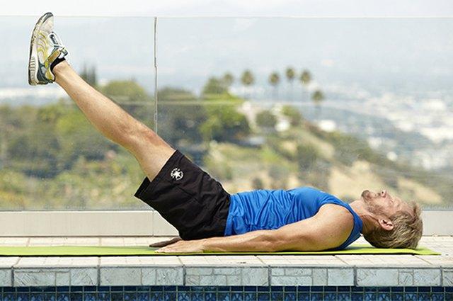 Man doing lying leg raise exercise for better sex