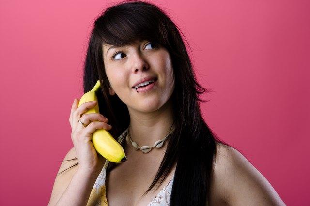 Woman holding banana