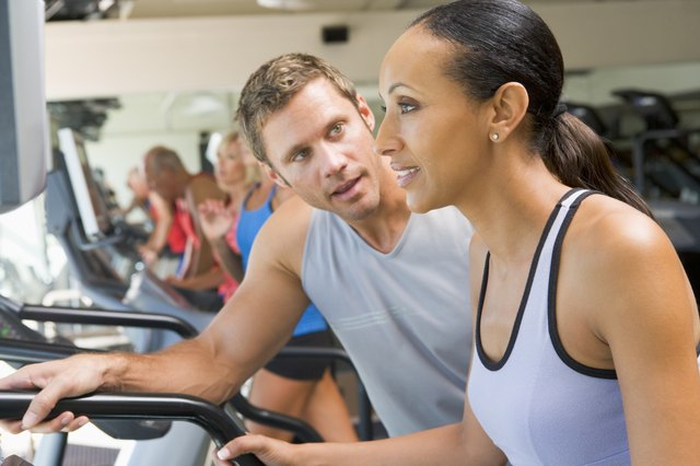 Personal Trainer Encouraging Woman