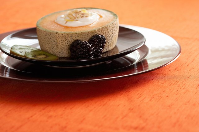 Yogurt in cantaloupe by kiwi and blackberries