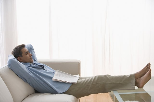 Hispanic man sleeping on sofa