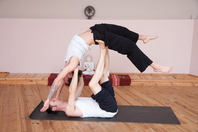 Doing Yoga Together In A Studio