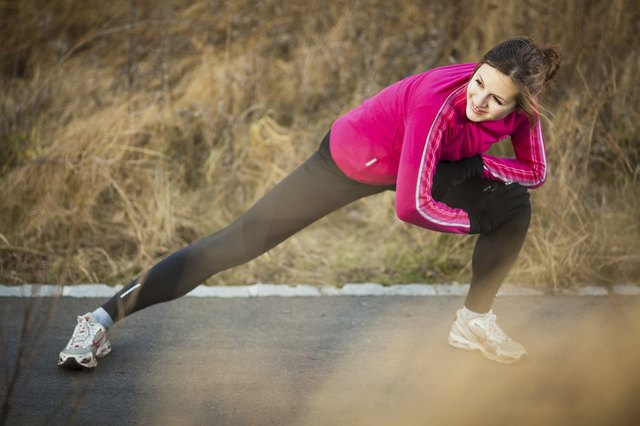 Young woman stretching before her run