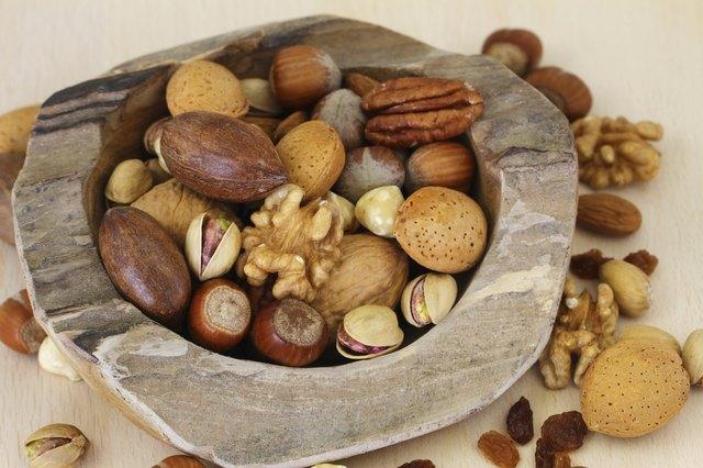 Nut variety in teak root bowl