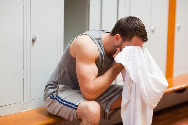 Sports student drying his head