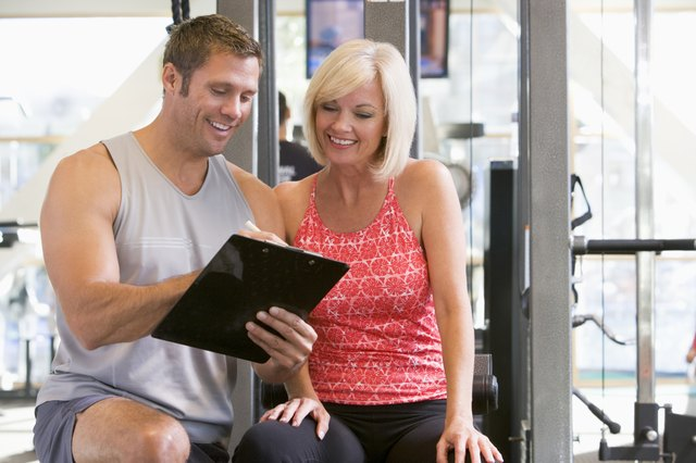 Personal Trainer taking induction with woman