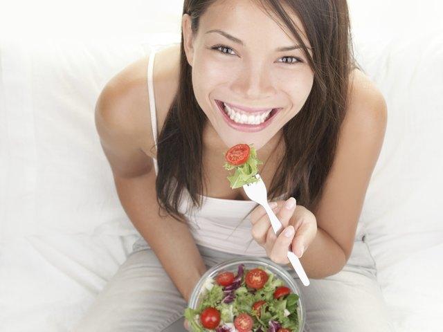 Girl eating healthy salad portrait