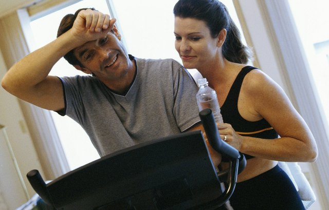 portrait of couple by exercise machine