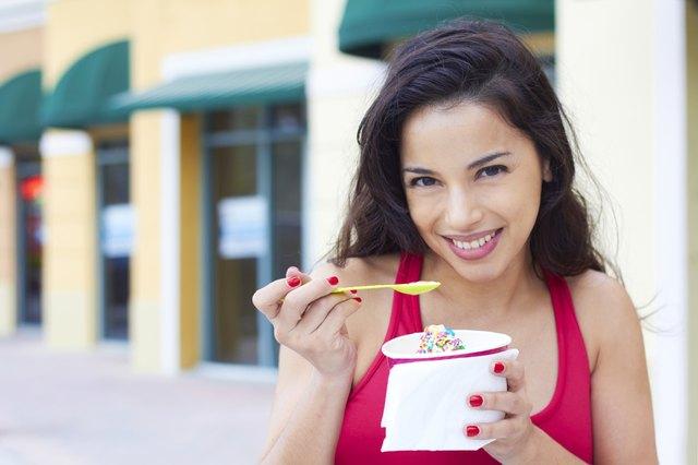 Young Woman Enjoying Frozen Yogurt