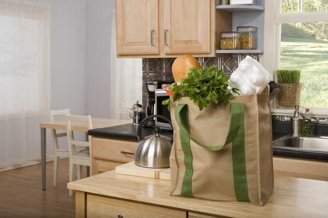 Reusable bag filled with groceries on kitchen counter